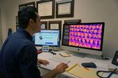 UCCE ag engineer Ali Pourreza views the virtual orchard on his computer.