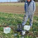 UC West Side REC agricultural technician Tracy Waltrip conducting soil hydraulic conductivity determination in the NRI Project field.
