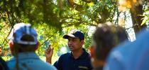 UCCE Integrated Pest Management advisor Jhalendra Rijal addresses farmers, pest control advisers and UC Master Gardener volunteers in a Turlock almond orchard. (Photo: Michael Rosenblum, UCCE Stanislaus County) for Green Blog Blog