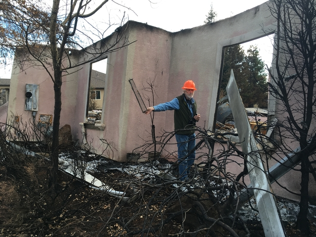 Steve Quarles and Yana Valachovic examined houses in Paradise after the devastating 2018 Camp Fire. Quarles holds up a vent screen that may have allowed embers to enter the house. Photo by Yana Valachovic
