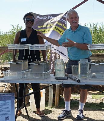 UCCE climate-smart educator Esther Mosase, left, and UCCE specialist Jeff Mitchell at a field day.