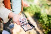 A compass is one of the tools professional foresters use to establish plots when collecting data about a forest.