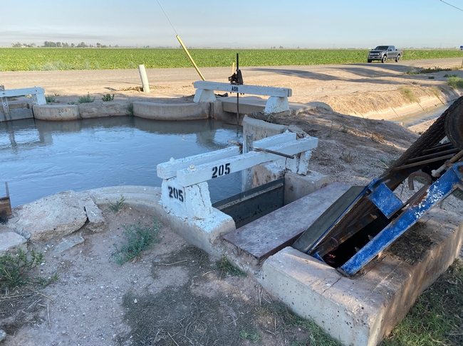 Water delivery gate to a farm. The flow rate can be measured from the water level in the main canal, gate width, and water level at the delivery point. Photo by Khaled Bali