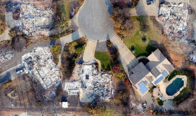 tThis photo captured by a drone shows a house that survived the 2018 Camp Fire among others that were destroyed. Photo courtesy of Butte County