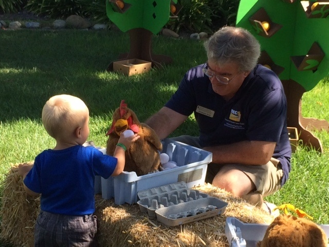 County Director, Christopher Smith, visits with a future farmer.
