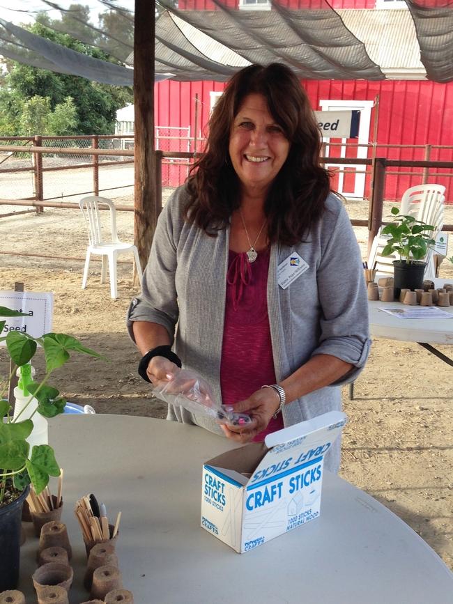 Master Gardener (MG) Elaine Pepe-Williams prepares Plant-a-Seed Center