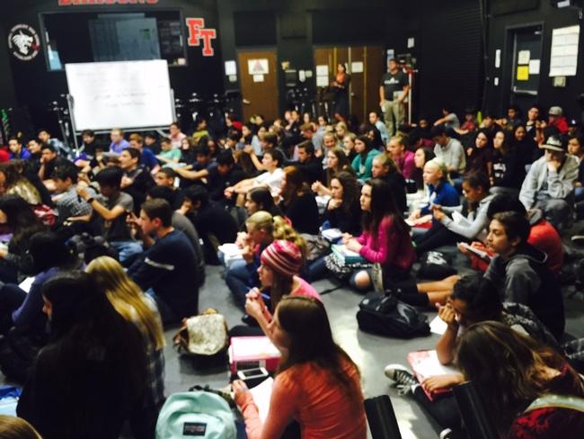 students crowd to hear presentation