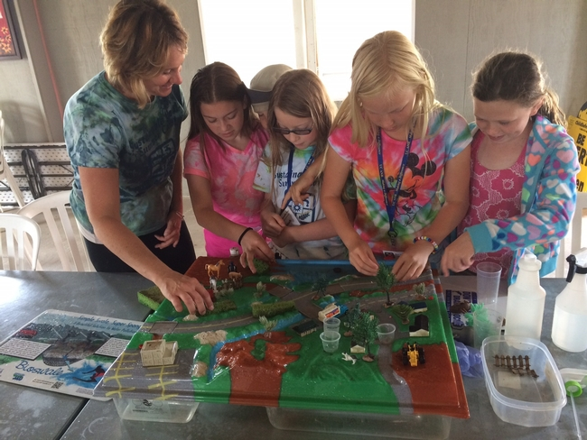 Jill Sarrick uses an interactive model to demonstrate concepts of a watershed