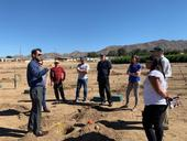 Amir Haghverdi showing plots to EarthWatch, UCCE and CBWCD teams