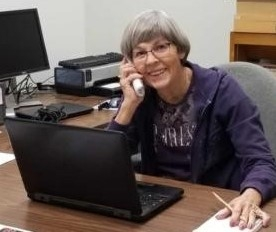 Master Gardeners answer helpline calls in the office