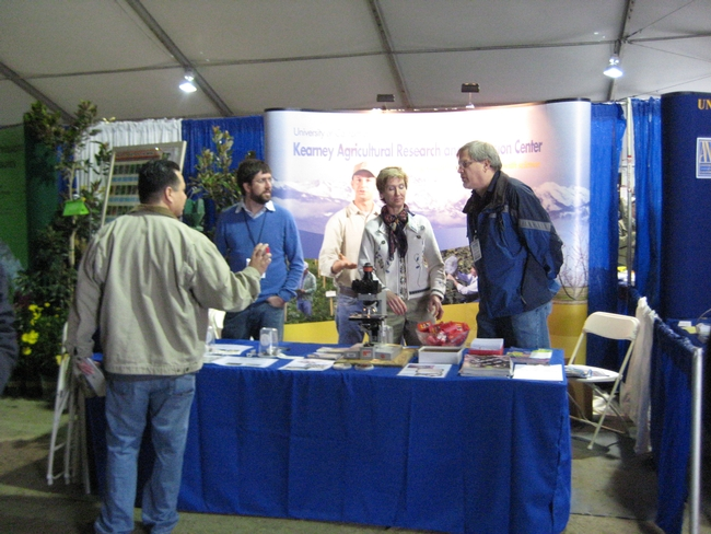 Computer resource specialist Robert Johnson, assistant program and facility coordinator Julie Sievert and KARE director Jeff Dahlberg answer questions at the KARE booth in Pavilion A.