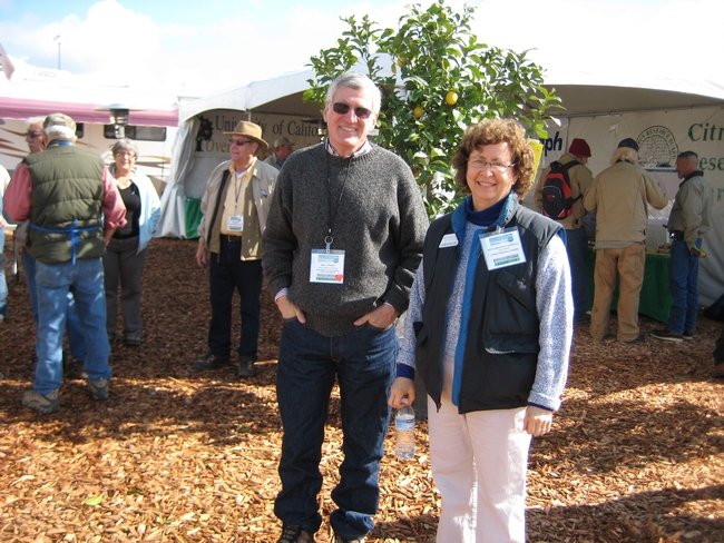 Director of the REC system Bill Frost visits Beth Grafton-Cardwell, director  of Lindcove Research and Extension Center, in a booth shared with the  Citrus Research Board.