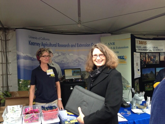 Vice President, Director of Agricultural Experiment Station, Director of Cooperative Extension, and Professor and Russell Rustici Chari in Rangeland Management, Barbara Allen-Diaz visiting Staff Research Associate, Julie Sievert, at the UC ANR KARE & REC System Booth.