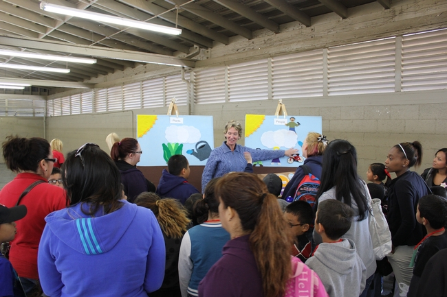 Students at the Fresno Farm and Nutrition Day discussing what it takes to be a healthy plant and what it takes to be a healthy person.