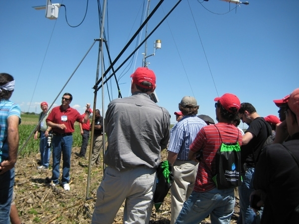 University of Nebraska's Suat Irmak, facing camera, explains how a high-technology weather station in Nebraska continuously monitors crop evapotraspiration and crop coefficients during the growing season. Irmak presents the keynote address to California farmers Sept. 12.