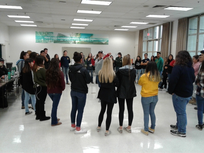 The students circle in a team-building exercise.