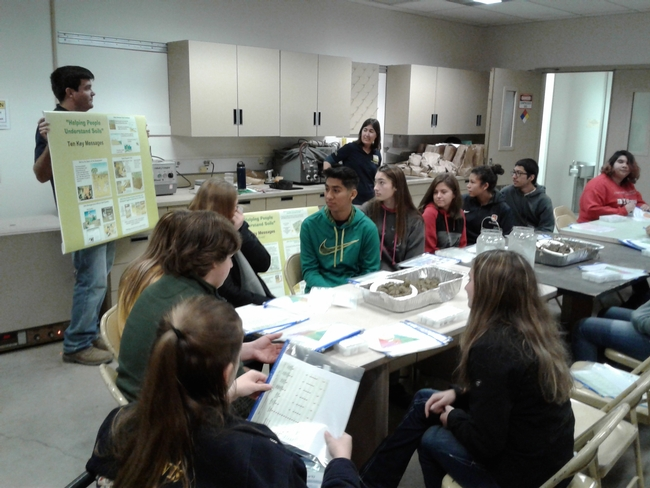Students learn that healthy soil produces healthy crops.