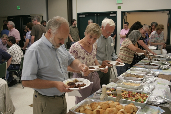 John and his wife Marcia lead the buffet line.