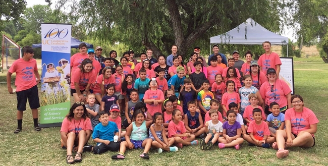 Campers pose for a photo with UC scientists during River Camp Firebaugh.