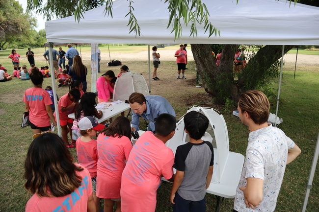 Campers learn from UC scientists at one of the river education stations.