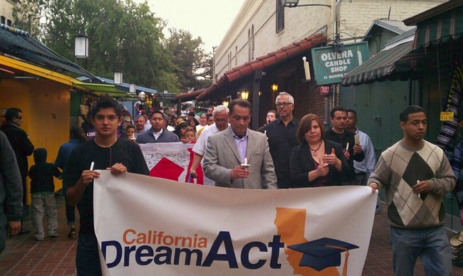 Assemblyman Gil Cedillo (center), demonstrators in Los Angeles sought and eventually won the passage of the California Dream Act. Credit: Fredy Ceja