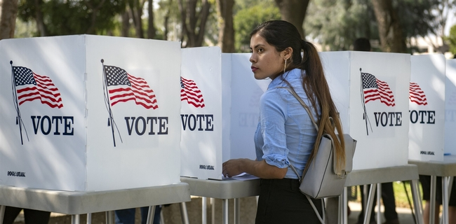 Destiny Martinez, 18, votes for the first time at the Power California early voting event and festival for students of the Los Angeles Unified School District on Oct. 24, 2018 in Norwalk. She said she liked the enthusiasm surrounding the day. Mindy Schauer / Orange County Register via Getty Images