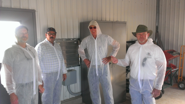 Nurserymen suit up for the protective structures tour at LREC