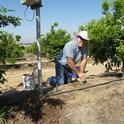 Craig Hornung installs a soil moisture sensor.