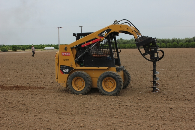 Don Cleek, LREC Ag Supervisor, augering tree holes in advance of planting.