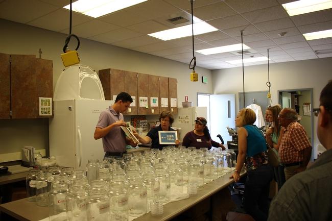 Entomology staff Josh Reger and Sara Scott explain their work