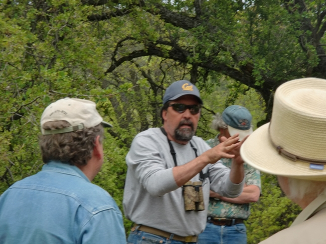 Greg Giusti, UCCE forester and wildlife biologist, speaking with landowners and managers on the field trip.