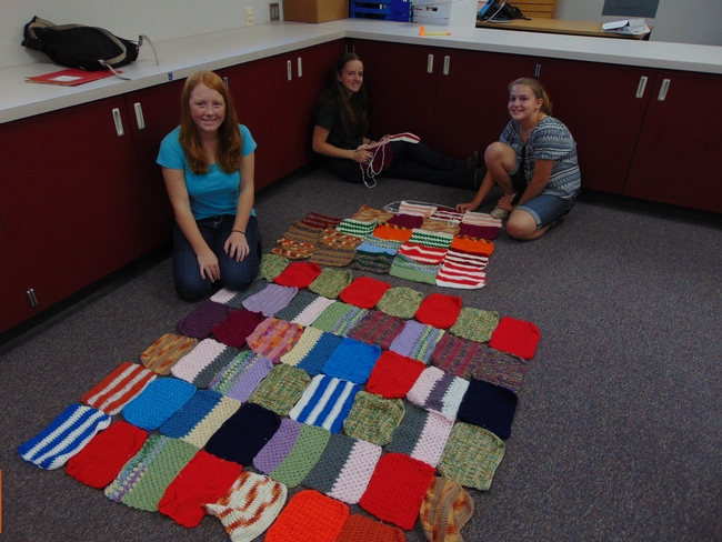 4-H girls work on putting together their blankets for Warm up America