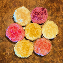 Fruit powder added to frosting on cupcakes.