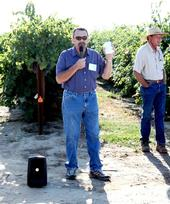 Jim Wolpert speaking at the 2011 Kearney Grape Day. His technician, Mike Anderson is standing on the right.