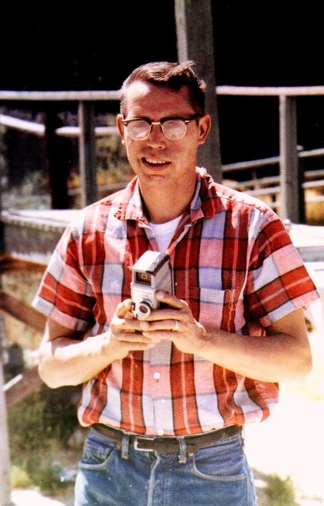 Daniel Martinez, father of Master Gardener, Michele Martinez, holding a super 8 film camera in the 1960s.