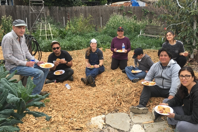 Gretchen Heimlich (3rd from left) and volunteers enjoying a delicious feast of food grown in the Strub Avenue Community Garden.