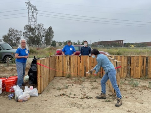 Debbie Cutting Ribbon on Composting Start Day
