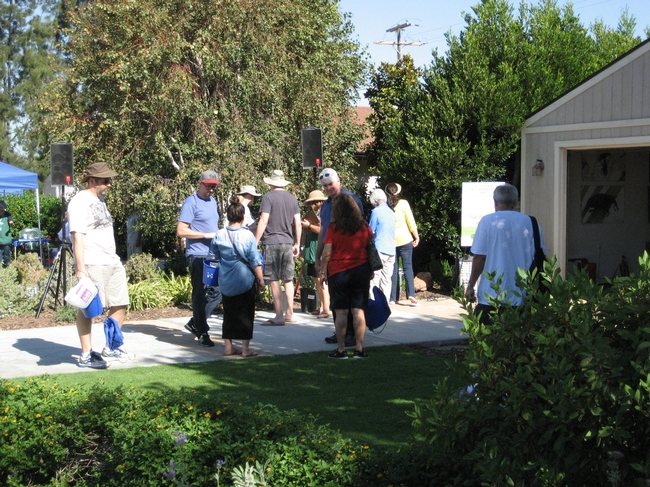 UCCE Master Gardener docents discuss low water use plants with interested visitors.
