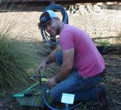 Danny Klittich does repairs to a bee watering station.  This ensures that our bees have the water they need.