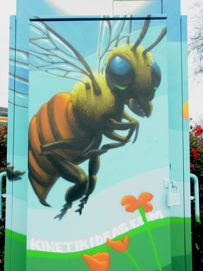 Closeup view of the bee on the painted utility box