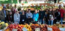 Local farmers tour Sebastopol's Community Market during a UCCE Tour to Meet Buyers in December for UCCE Sonoma Blog