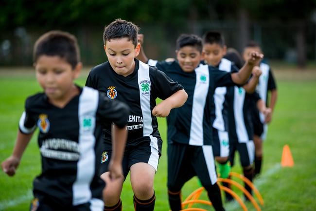 After school program - practicing soccer hurdles