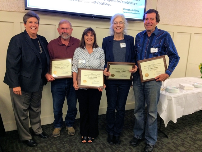 Bob Van Steenwyk, Lucia Varela, Rhonda Smith and Frank Zalom of the EGVM Team in 2016 accepting the UCANR Distinguished Service Team Award with Glenda Humiston, VP UC ANR