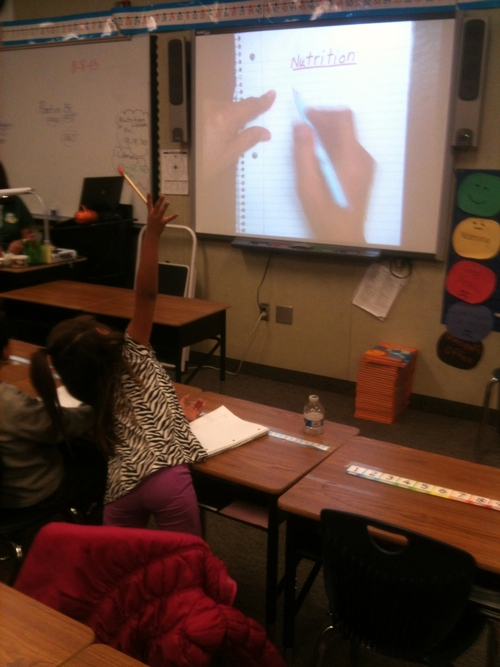 Student learning about nutrition during a writing lesson.