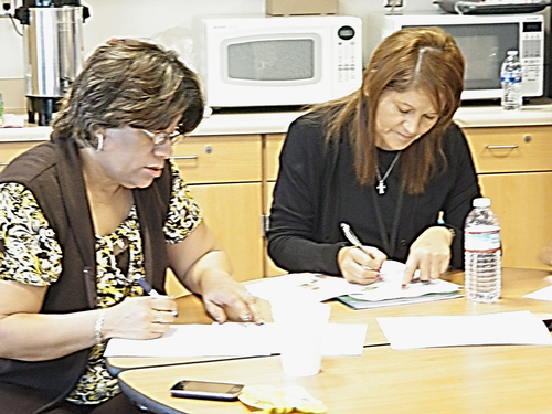 Ben Benavidez Elementary School parents practice making a written grocery list while planning meals ahead of time.