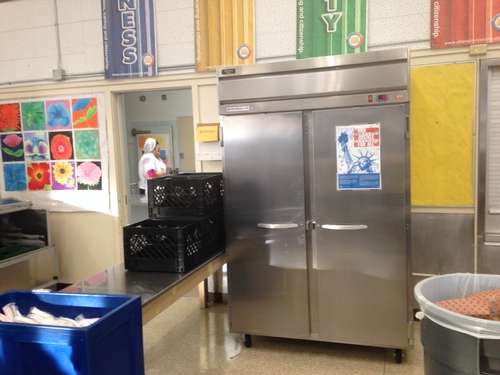 Before: A large freezer blocked off the front of the cafeteria, leaving little room for nutrition education materials and a place to showcase student artwork.