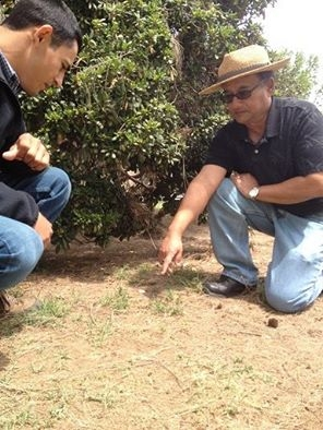 Dr. Shrestha in the field with student.