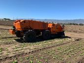 Photo 2. FarmWise Titan autonomous tractor equipped with split knives