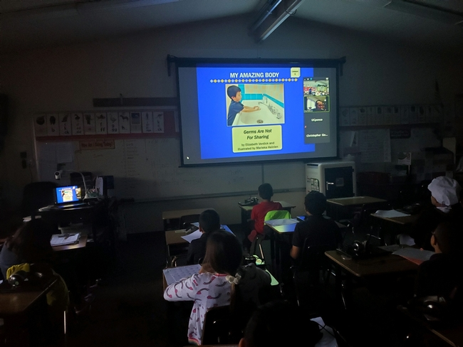 Photo of slideshow in classroom with students