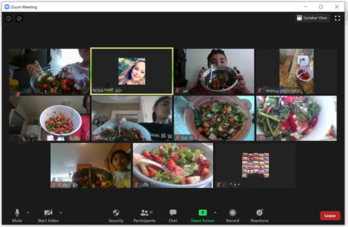 Zoom capture of 9 computer screens with youth and adults in SNAC Club showing the strawberry salads they each created at home.